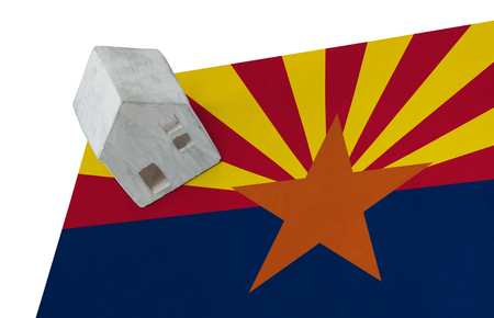 Small house on a flag - Living or migrating to Arizona