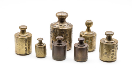 Old brass antique weights, Holland, isolated on white Banco de Imagens