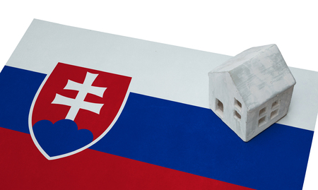 real estate house: Small house on a flag - Living or migrating to Slovakia Stock Photo