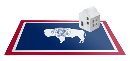 real estate house: Small house on a flag - Living or migrating to Wyoming
