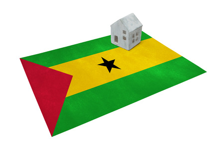 Small house on a flag - Living or migrating to Sao Tome and Principe Stock Photo