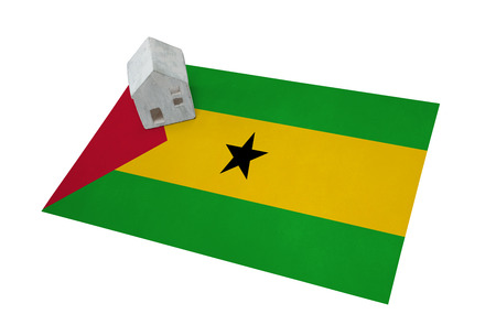 real estate house: Small house on a flag - Living or migrating to Sao Tome and Principe Stock Photo