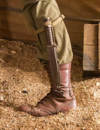 Close-up of a soldier with a knife, vintage