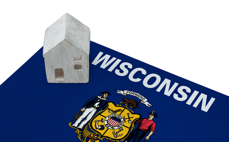 Small house on a flag - Living or migrating to Wisconsin Stock Photo