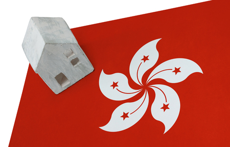 Small house on a flag - Living or migrating to Hong Kong Stock Photo
