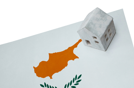 realestate: Small house on a flag - Living or migrating to Cyprus Stock Photo