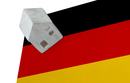 Small house on a flag - Living or migrating to Germany