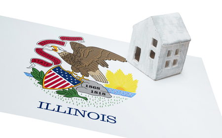 investment real state: Small house on a flag - Living or migrating to Illinois