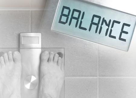 Closeup of mans feet on weight scale - Balance