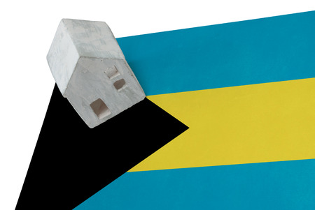 Small house on a flag - Living or migrating to Bahamas Stock Photo