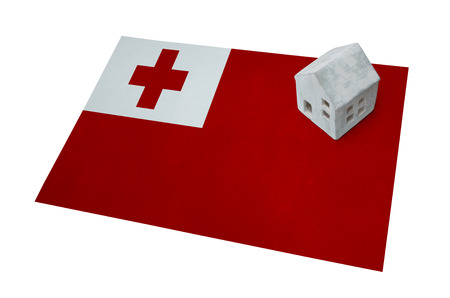 Small house on a flag - Living or migrating to Tonga Stock Photo