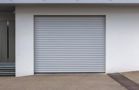 New door of a garage, empty street