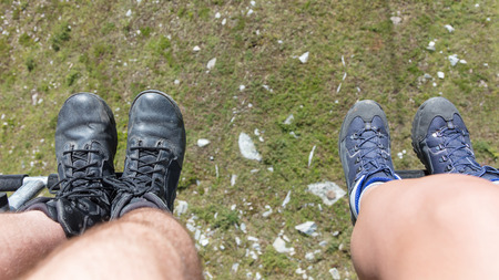 Male and female hiker riding a chairlift - Summer in Austria