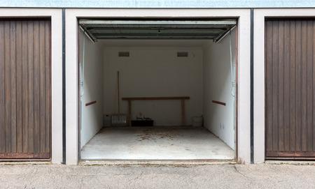 Old brown door of a garage, empty street