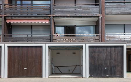 Old brown door of a garage, apartment complex Banque d'images