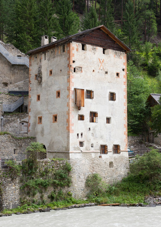 Medieval castle Altfinstermunz, in the valley of the Inn River, European Alps, near the village Nauders. The castle was built in 1472.