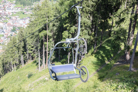 tripped: Ski lift chair in the Alps - Unrecognisable man in it - Austria
