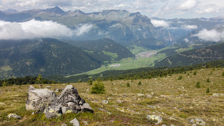 View of beautiful landscape in the Alps - Clouds rolling past the mountains