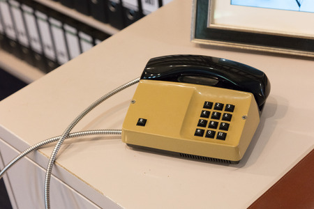 Old telephone in an office - Selective focus