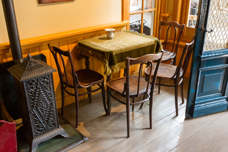 dining table and chairs: Interior of a very old bar - Table and chairs
