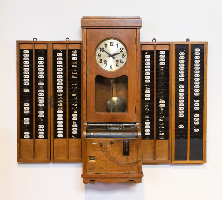 Vintage time clock on a white background Stock Photo