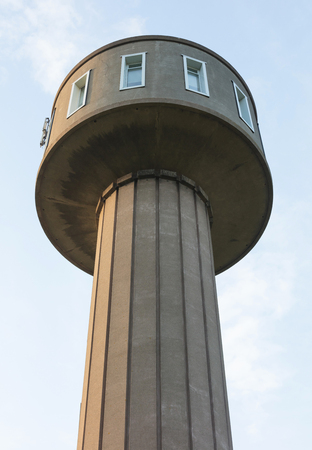 converged: Old water tower from the 1950s converged to an apartment - the Netherlands