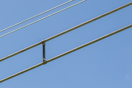 Electicity wires hanging in the blue sky - Selective focus