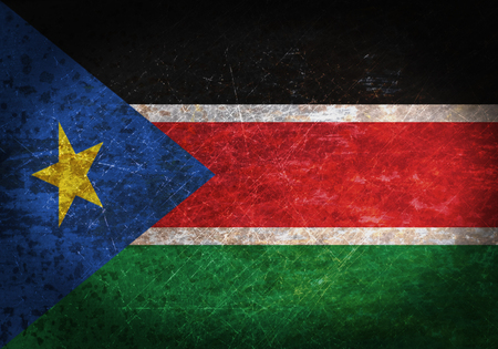 Old rusty metal sign with a flag - South Sudan Banque d'images