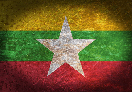 Old rusty metal sign with a flag - Myanmar