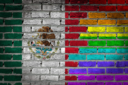 Very old dark red brick wall texture - Flag of Mexico with rainbow flag