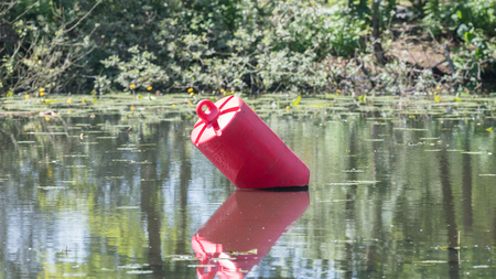 Red buoy in a large pond - Selective focus