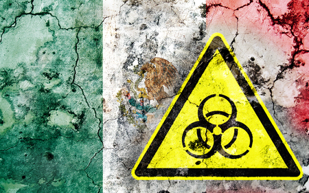 Old cracked wall with biohazard warning sign and painted flag, flag of Mexico
