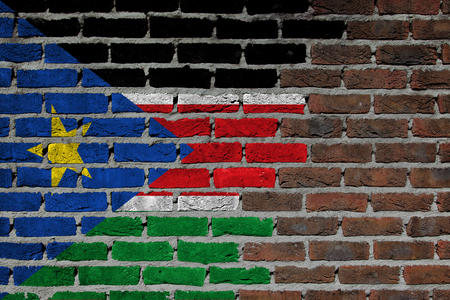 concrete surface finishing: Very old dark red brick wall texture - Flag of South Sudan Stock Photo