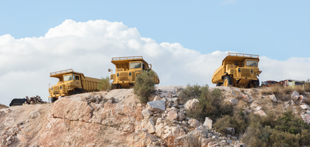 Old industrial trucks for stone waiting on a site in Greece
