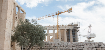 Ancient Parthenon surrounded by scaffolding on the Athenian Acropolis, Greece