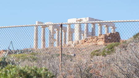 Protection the Greek heritage - Temple of Poseidon in cape Sounion - Southern Greece Stock Photo
