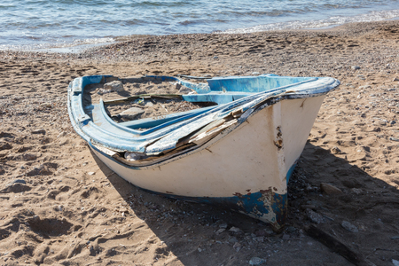 Old boat on the banks of the sea, Greece
