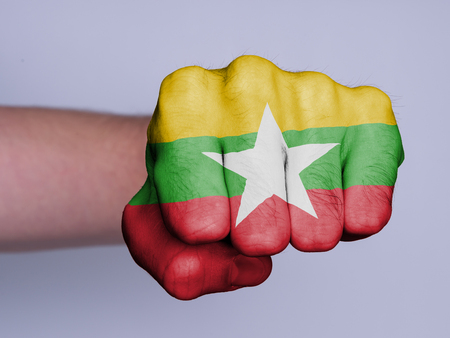Very hairy knuckles from the fist of a man punching - Myanmar