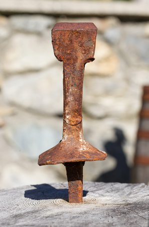 Excalibur sword in wood - Rusted and forgotten
