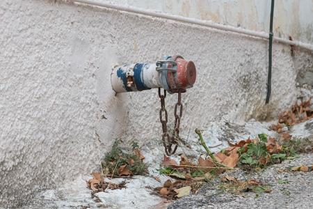 Drain in a wall, small village in Greece