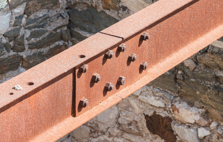 Rusted metal support beam of an old bridge