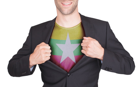 Businessman opening suit to reveal shirt with flag, Myanmar
