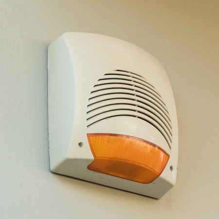 Alarm hanging on a wall - Private home