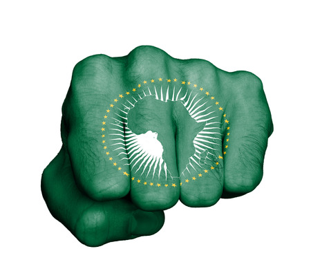 Very hairy knuckles from the fist of a man punching - African Union