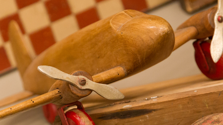 Wooden airplane, small toy - Selective focus on the prop