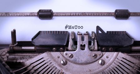 Vintage inscription made by old typewriter, #Metoo as a new movement worldwide - Against harassment of women