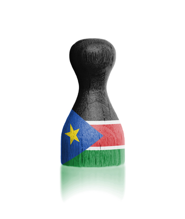 Wooden pawn with a painting of a flag, South Sudan