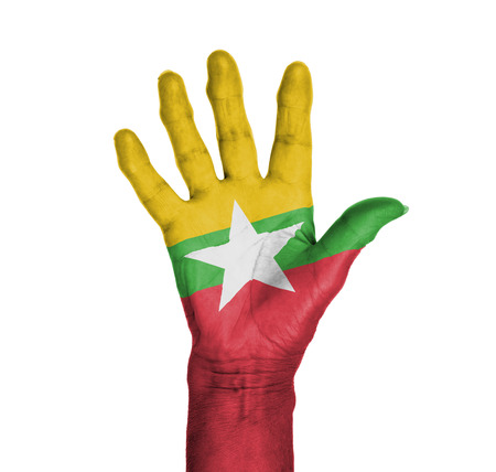 Palm of a woman hand, painted with flag of Myanmar