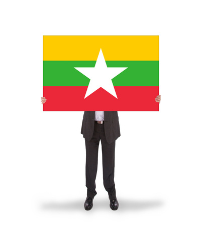 Businessman holding a big card, flag of Myanmar, isolated on white