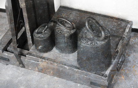 Old brass antique weights with an industrial scale - The Netherlands